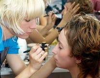 Make-up. Putting make up with brush royalty free stock photos