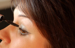 Make up #7. Beautiful woman making make-up Royalty Free Stock Photo