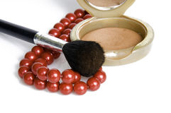 Make-up.... Compact powder mirror and brush Royalty Free Stock Photo