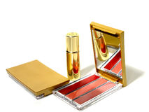 Make up. Lipstick and gold makeup compacts stock photography