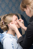 Make-up. Make up with a cosmetic stick Stock Images