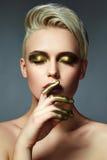 Make-up antiek goud stock afbeeldingen