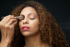 Make up application on a beautiful young african american woman Stock Photography