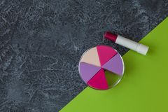 Make up applicators and lipstick on natural dark stone background with copy space stock photos