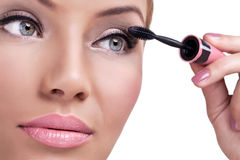 Make-up, applying mascara Stock Photos