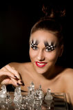 Make-up art in the form of chessboard Stock Images