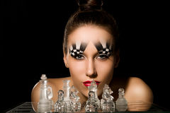 Make-up art in the form of chessboard Stock Image