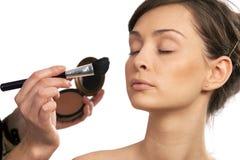 Make-up artist. Backstage scene: Professional Make-up artist doing glamour model makeup at work royalty free stock photo
