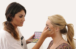 Make Up Artist. Applying cosmetics on a client Royalty Free Stock Photography