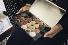 Make up artist. Holding paints Royalty Free Stock Image