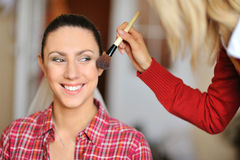 Make-up artist in action Royalty Free Stock Images