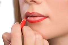 Make-up artist apply bloody lipstick Royalty Free Stock Photos