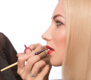 Make-up artist apply bloody lipstick Stock Images