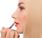 Make-up artist apply bloody lipstick Royalty Free Stock Photography