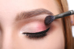 Make-up artist apply eyeshadow with brush, beauty. Eyeshadow applying, makeup for eyes closeup. Female model face with fashion make-up, beauty concept isolated stock photo