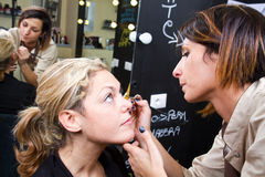 Make-up artist  applying eyebrow make-up Stock Images