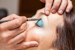 Make up artist applying eyeshadow Stock Photos