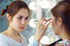 Make-up artist applying eyeshadows Royalty Free Stock Image
