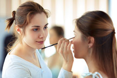 Make-up artist applying eyeshadows Stock Photography