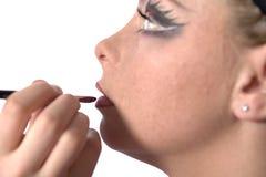 Make up artist applying lipstick stock images