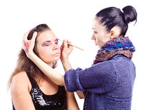 Make up artist applying make up on actress Stock Photography