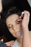 Make up artist applying make up Stock Photos