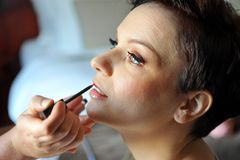 Make up artist applying make up Royalty Free Stock Photo