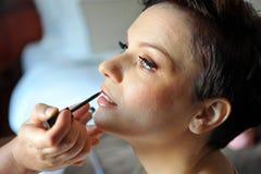 Make up artist applying make up Royalty Free Stock Photo