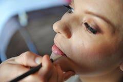 Make up artist applying make up Royalty Free Stock Image