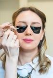 Make-up artist applying makeup. Stock Photos
