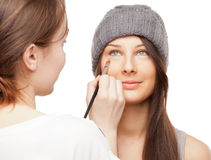 Make-up artist applying makeup onto performer's face Royalty Free Stock Photography