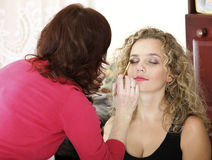 Make up artist applying makeup to a fashion model Royalty Free Stock Photos