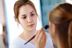 Make-up artist applying powder Royalty Free Stock Images