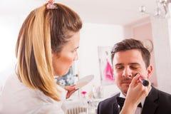 Make-up artist artist doing young man Stock Image