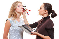 Make up artist with beautiful model Royalty Free Stock Photo