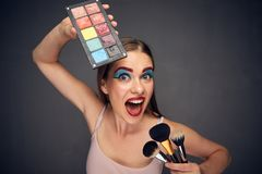 Make up artist with crazy emotion. Stock Photography