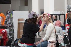 Make-up artist depicts girl at Animefest Royalty Free Stock Photography