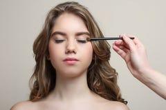 Make-up artist does make-up Stock Images