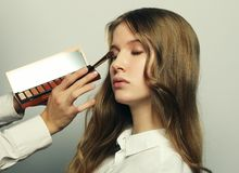 Make-up artist doing make-up beautiful girl, beauty concept and Royalty Free Stock Image