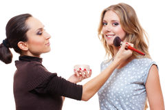Make-up artist doing make-up with brush Royalty Free Stock Photos