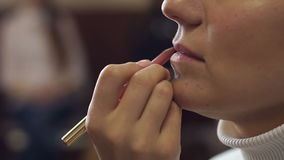 Make-up artist doing make-up for a girl close-up. stock video footage