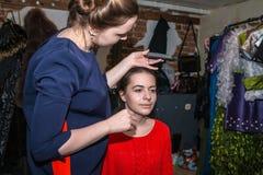 Make-up artist doing the make-up for nice girl Stock Image