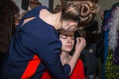 Make-up artist doing the make-up for nice girl Royalty Free Stock Image