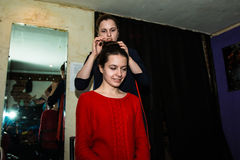 Make-up artist doing the make-up for nice girl Stock Photography