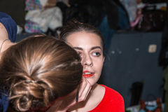 Make-up artist doing the make-up for nice girl Royalty Free Stock Photos