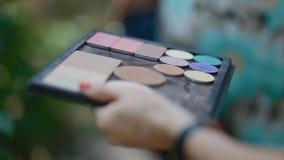 Make-up artist doing make-up stock video footage
