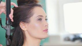 Make up artist doing professional make-up lips stock video