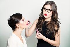 Make-up Artist Girl Applying Lip Gloss Royalty Free Stock Photography