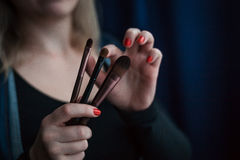 Make-up artist. Holding a brush in his hand Stock Images