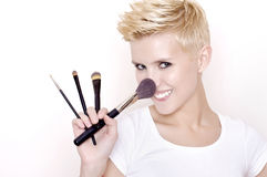 Make-up artist holding brushes Stock Images